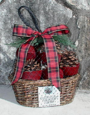 This is a fireplace fire starter gift basket containing 12 wax-bottom cinnamon scented Kindle Cones for starting your fireplace or woodstove.  They are in an unpeeled willow basket and are finished with a red plaid ribbon.